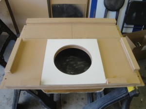 Then i attached a top baffle to the enclosure, and started building spacers and supports for the sub and amps. the sub part i applied white vinyl